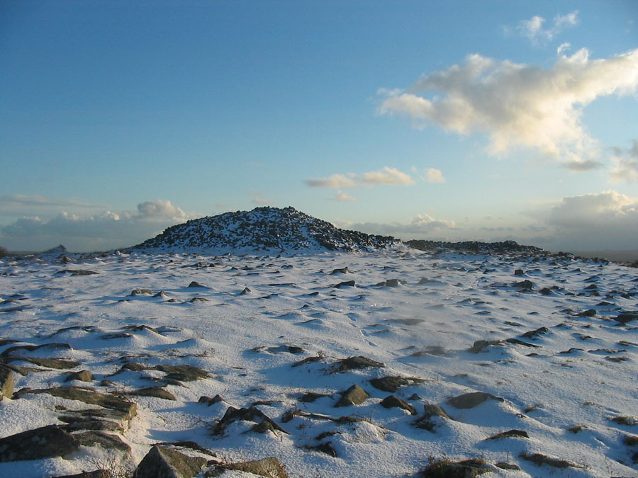 Snow over Bronze Age Barrow on Carburrow Tor.jpg