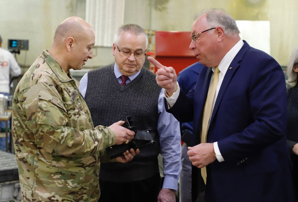 MG Anthony C. Funkhouser and Michael Schultz (Chief of Interagency and International Services Div, Military Programs, U.S. Army Corps of Engineers) examine exhibit components with D&P company president J.F. Barnwell.