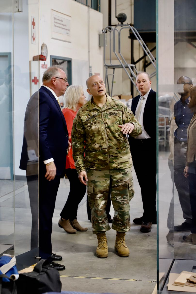 D&P company president J.F. Barnwell shows display cases to MG Anthony C. Funkhouser and National Museum of the United States Army staff.