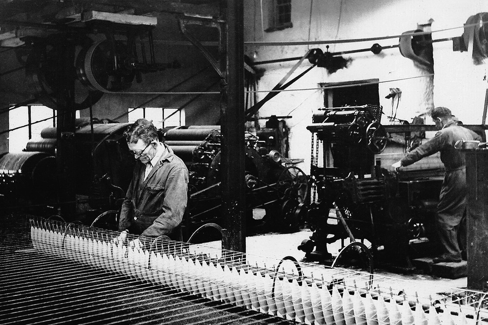 Henry spinning & Howard weaving in the Mill