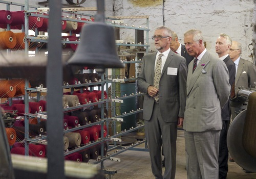HRH entering the weaving shed
