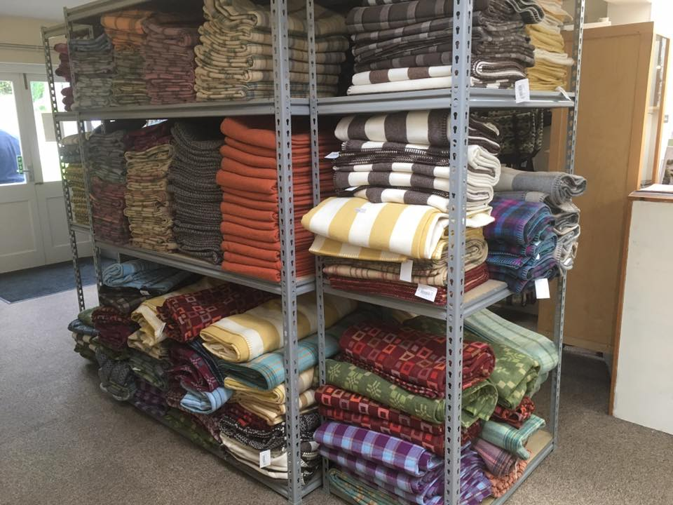 sale blankets and throws piled high