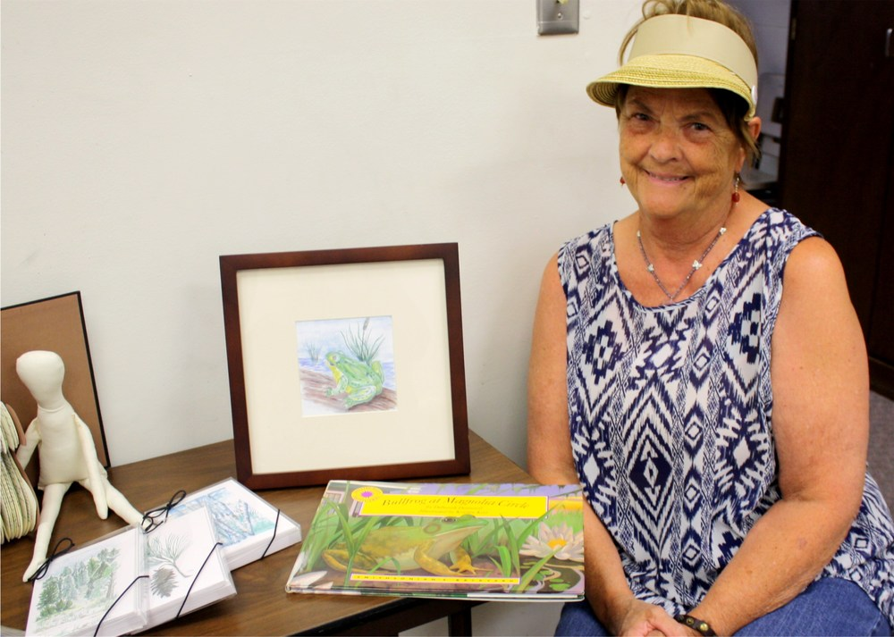 "Framed Frog Print and ""Bullfrog of Magnolia Circle"" book by June Shephard Reserve: $30"