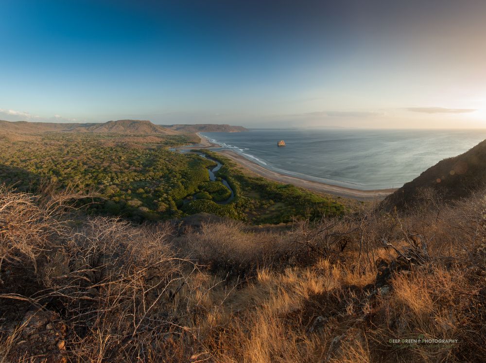 view over Playa Naranjo as the sun sets during the dry season in Santa Rosa National Park
