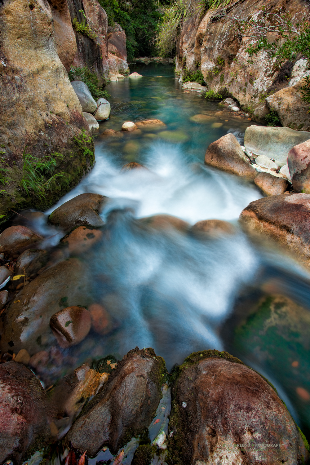 the Rio Blanco below Rincon de la Vieja National Park has colorful water resulting from volcanic activity