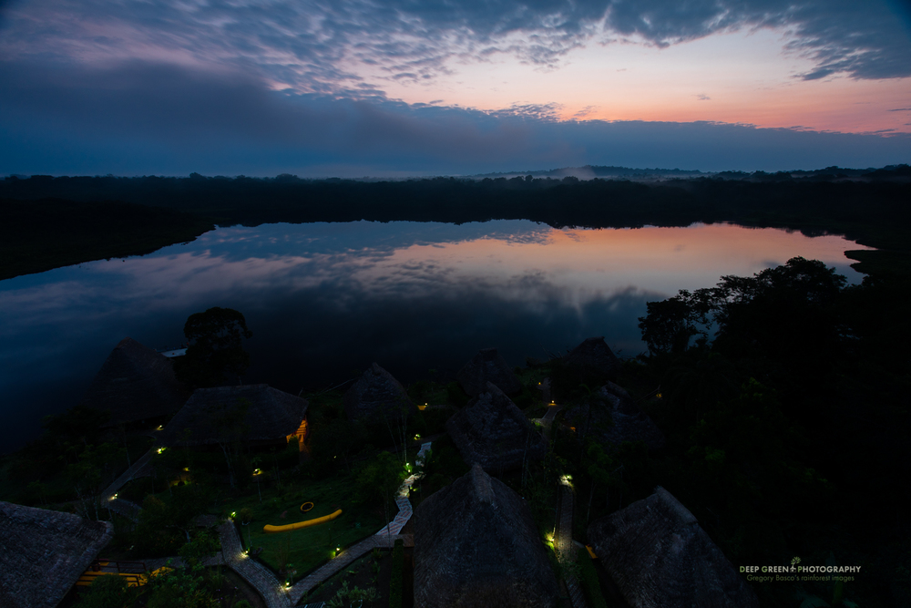 Dawn breaks over a rainforest lodge owned and operated by an indigenous tribe in the Amazon region of Ecuador