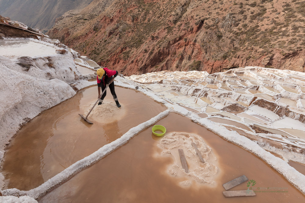 Salt mines in the sacred valley of Peru are a source of income for numerous local people who tend to individual salt ponds in a complex system of rules and benefits