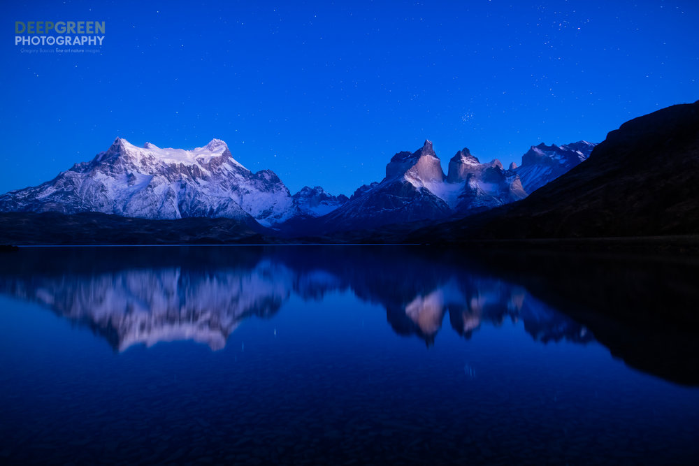 """Chile's Torres del Paine National Park is an amazing place. While leaving my lodge before dawn to photograph a sunrise at a different locale, I was drawn to this placid scene of a starry sky with the famed """"Horns of the Paine"""" reflected in a calm lake about an hour before the sun came up over the horizon. I missed my planned sunrise shot but it was totally worth it!Canon 5DsR, Rokinon 24 mm f/1.4 lens, Induro tripod, cable release, f/11, 13 seconds, ISO 1000"""