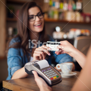 stock-photo-41110874-woman-paying-with-credit-card-at-cafe.jpg