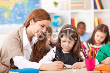 stock-photo-34800820-teacher-helping-students.jpg