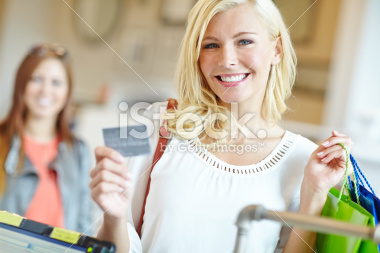 stock-photo-33300636-she-loves-the-freedom-of-her-credit-card.jpg