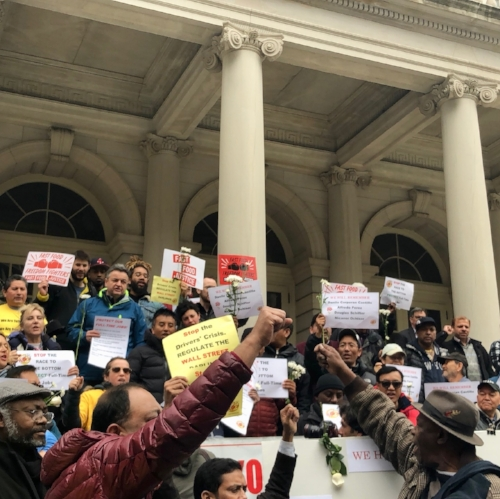 "NYTWA members chanting, ""We Need Action Now!"" in the wake of four driver suicides."
