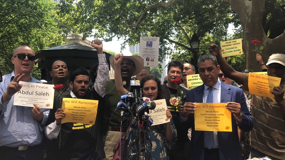 NYTWA members outside City Hall Gates on June 18th honor Brother Abdul Saleh, the sixth driver to take his own life in recent months due to economic desperation. Drivers were joined by Council Member Ruben Diaz, Sr. & Congressman Adriano Espaillat