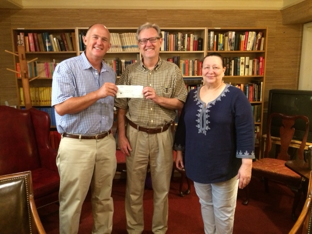 Rick Thomas (center), Partner at EagleFirst, LLC, presents a check for $3,000 to Samaritan Community's Director of Community Relations, Peter Dunn and Program Director, Sharon Krieger.