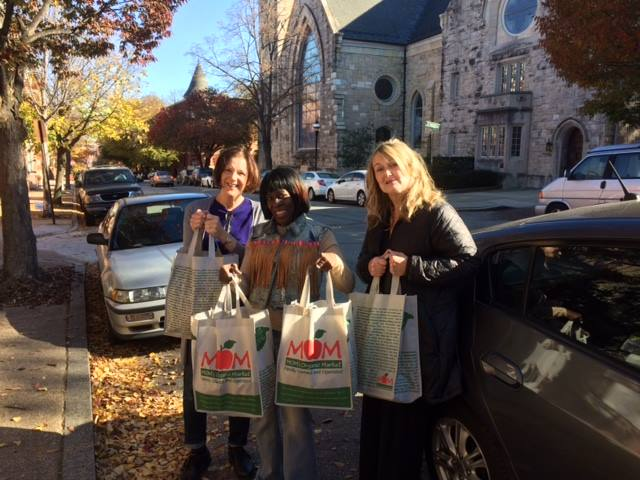 Baltimore Shambhala Center members donate Thanksgiving meals to Samaritan Community.