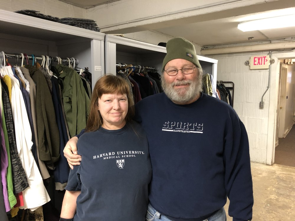 """Jim and Angel give back to others as volunteers who manage our clothing """"shop."""""""