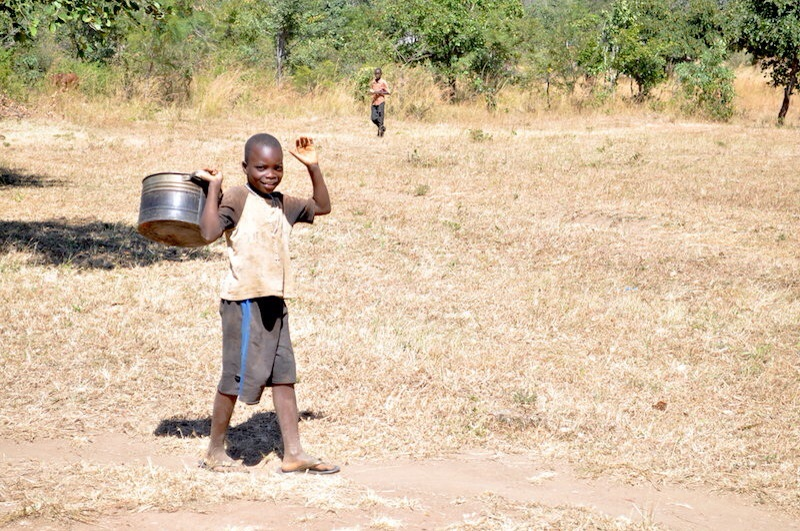 The burden of collecting water lies on women and children. You almost never see men pumping or carrying water.