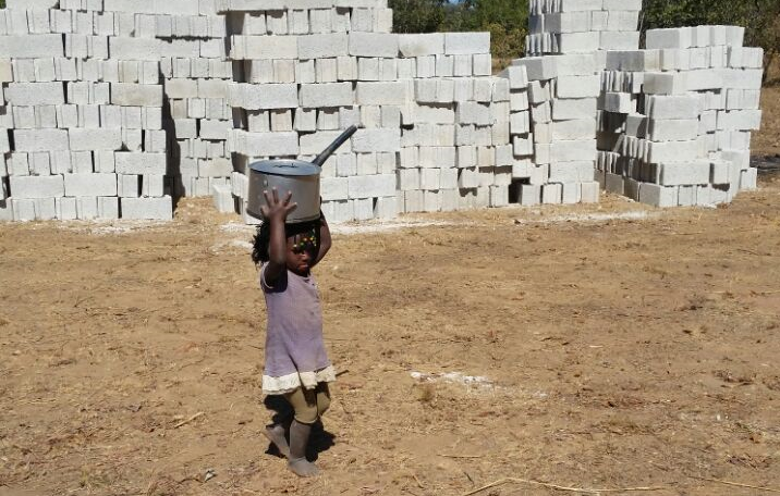 Lois, 3 years old, is Peter's daughter and #1 food deliverer on the construction site! :)