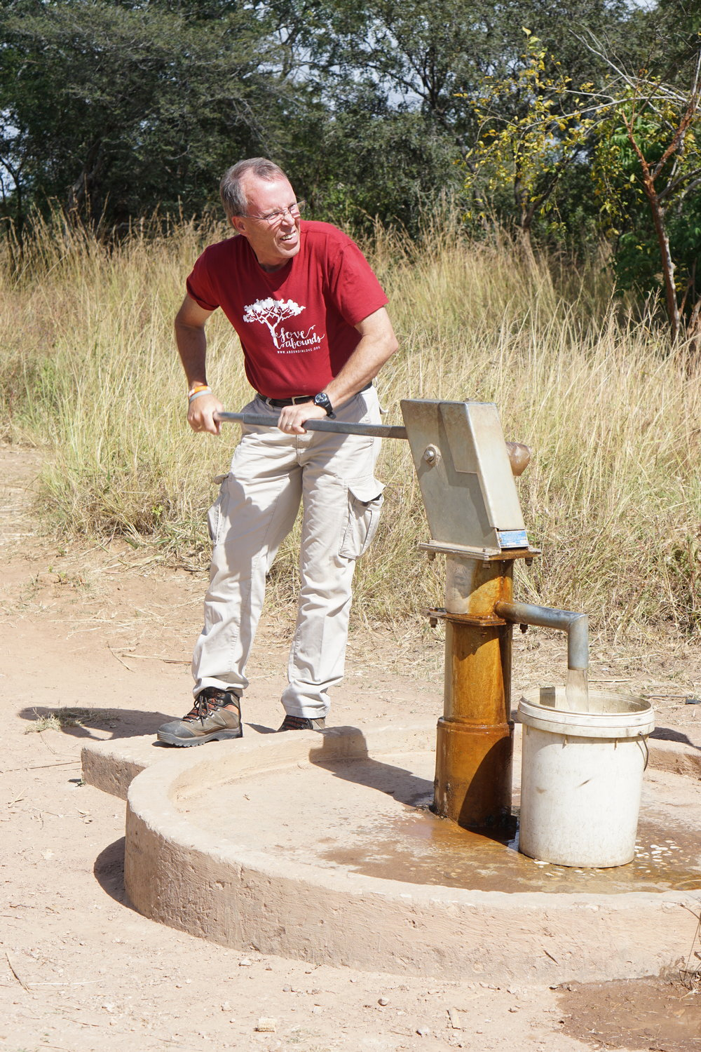Tony Curl pumps clean water from Kunchubwi Village borehole
