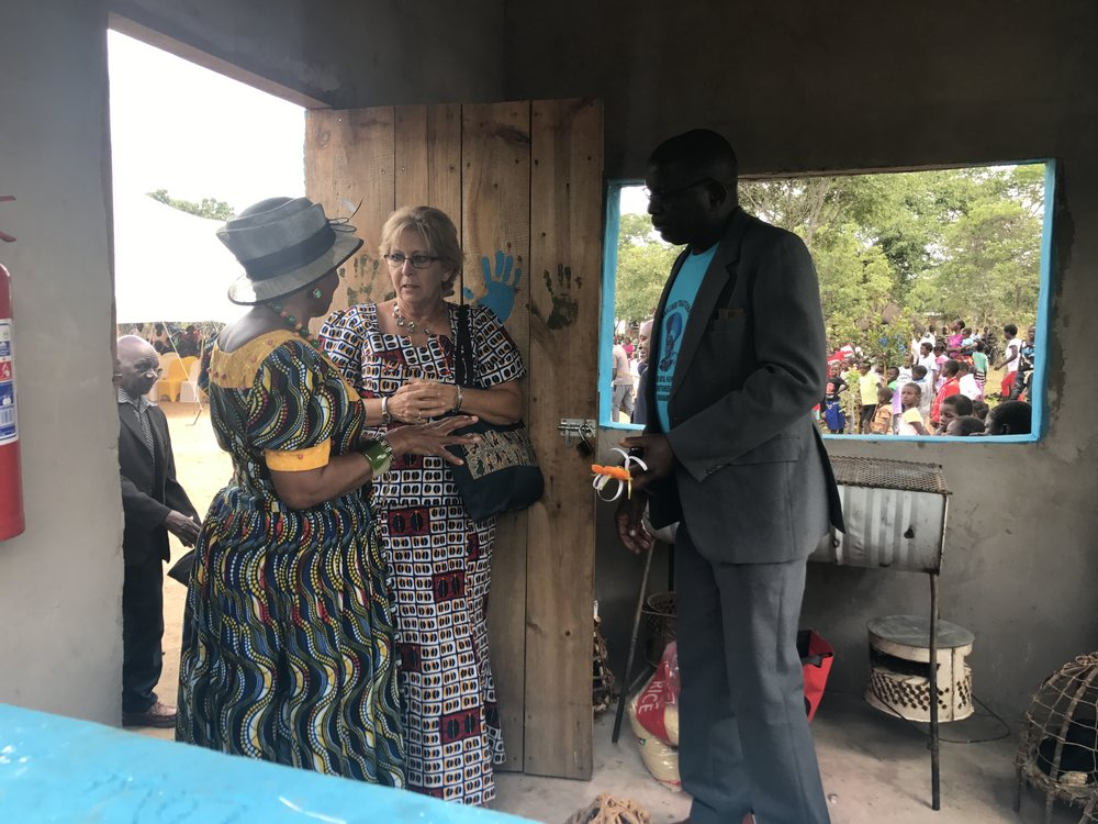 Carol showing the Chieftainess the kitchen of Life Okendewa