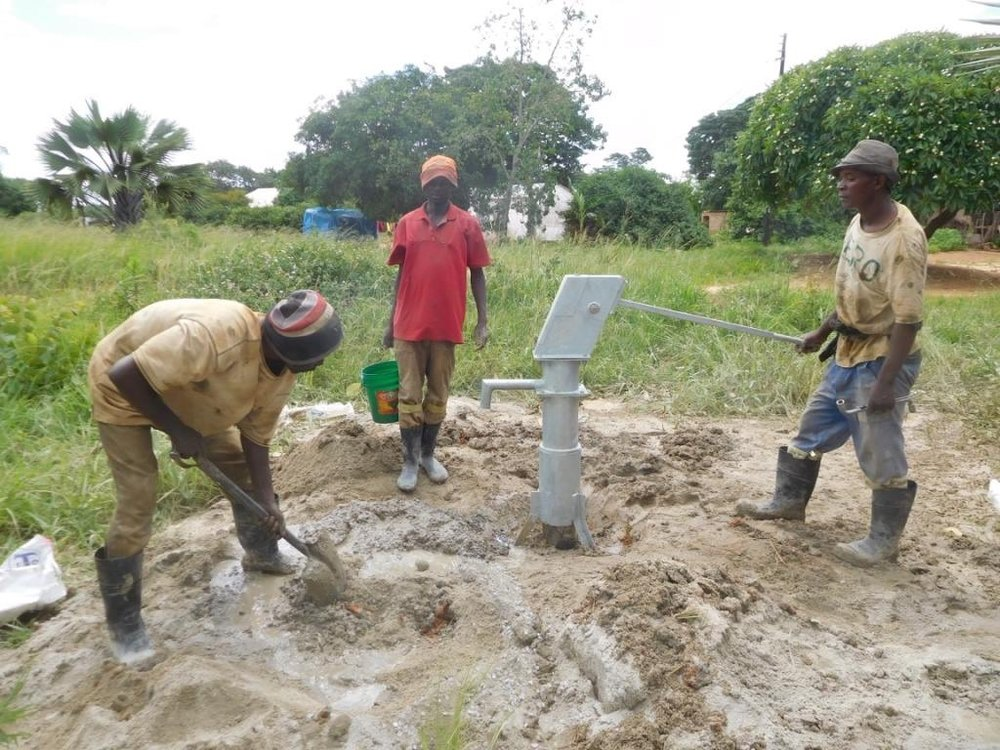 Pumping - as easy as turning on the faucet! Just kidding! As the American teenagers learned this summer, pumping is hard work! Thankfully, this borehole only needs a couple pumps before the water starts flowing!!