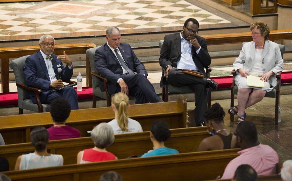 At a forum to discuss the events in Ferguson, MO, citizenship, and social change at Marsh Chapel September 3, 2014, the panel members were Dr Walter E Fluker, Martin Luther King, Jr. Professor of Ethical Leadership, from left, Capt Thomas Robbins, BUPD, Linwood Blizzard, II, Ph.D. Student in Practical Theology at BU, and Dean of CAS Virginia Sapiro. Photo by Cydney Scott for Boston University Photography