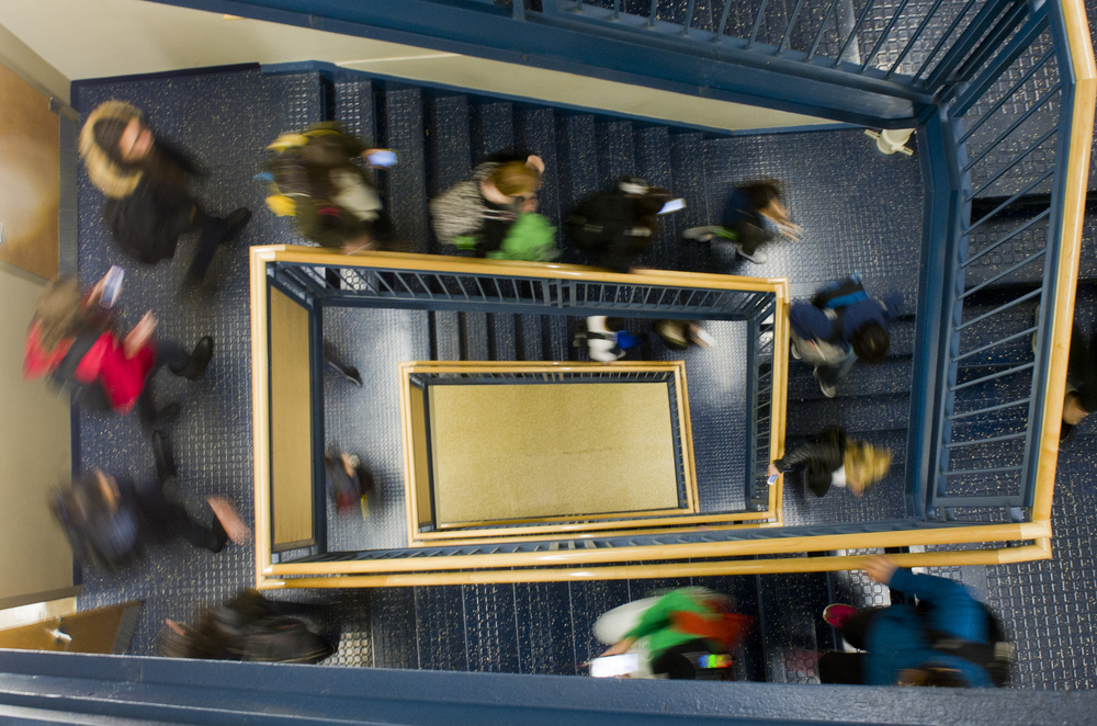 Students hit the stairs between classes at CGS November 6, 2014. Photo by Cydney Scott for Boston University Photography