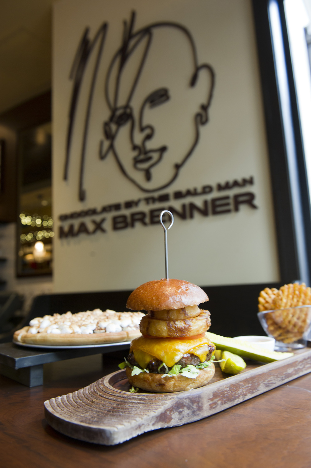 The Brenner Burger with Max's secret bbq sauce, cheddar cheese and a fried vidalia onion ring at Max Brenner's on Boylston Street November 16, 2011. Photo by Cydney Scott for Boston University Photography
