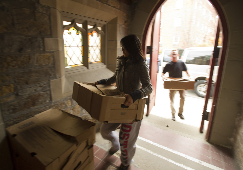 Kim Truong (CAS,'13) helps deliver 48 turkeys to the Brookline Emergency Food Pantry in St. Paul's Episcopal Church in Brighton November 21, 2011. By the end of the day, the group of volunteers  will have collected 1000 additional pounds of turkey and 1000 pounds of sides in preparation for Thanksgiving.  Photo by Cydney Scott for Boston University Photography