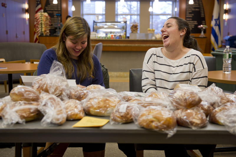 Gabriella Salpeter (CAS,'13) left, and Kayla Rosenberg (SAR,'14) chat while selling challah at the Hillel House for Challah for Hunger February 2, 2012. Rosenberg, who helped bake all 65 loaves, said that the proceeds go to various charities.   Photo by Cydney Scott for Boston University Photography