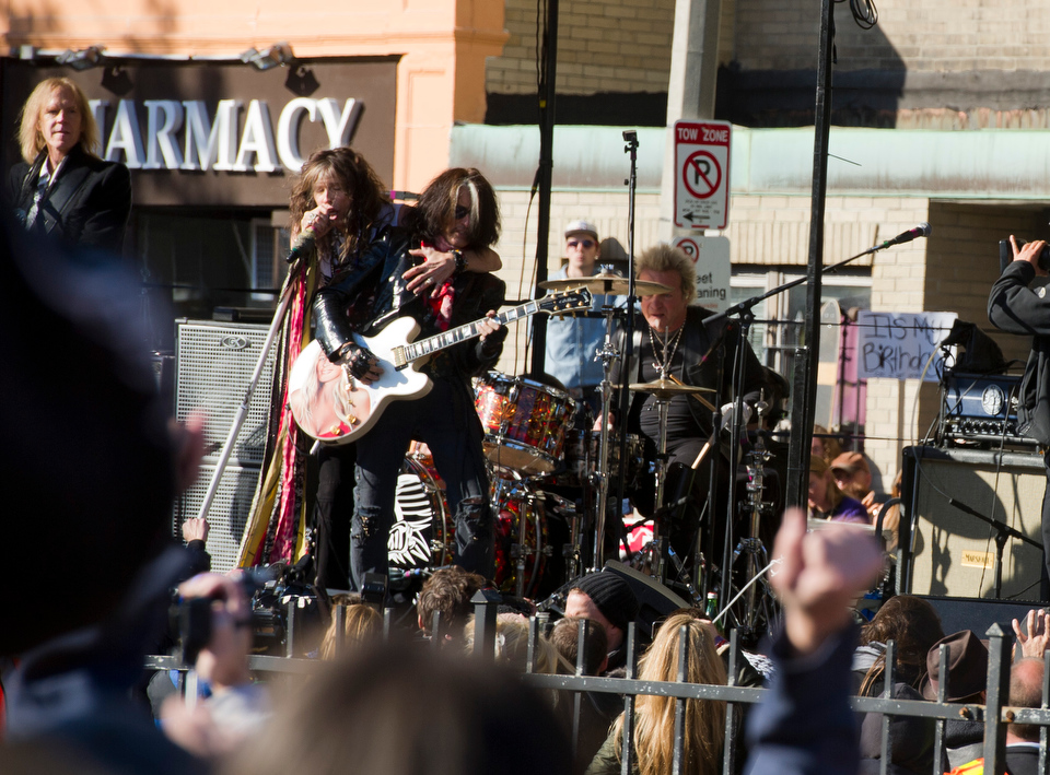 Aerosmith performs a free outdoor concert November 5, 2012, in front of 1325 Comm Ave. where the band members used to live in the early 1970s. The concert comes on the eve of the release of the band's 15th album, Music from Another Dimension.  A plaque was displayed in their honor at the building.  Photo by Cydney Scott for Boston University