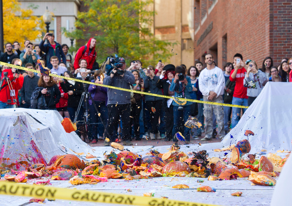 A 78 pound pumpkin, the largest of all tossed from the roof of the Metcalf, lands at the foot of the Metcalf Science Center during the Annual Pumpkin Drop October 26, 2012.   Photo by Cydney Scott for Boston University