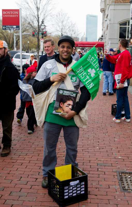 Vendors give out free flags with a $3 Red Sox program April 20, 2013 in Kenmore Square.
