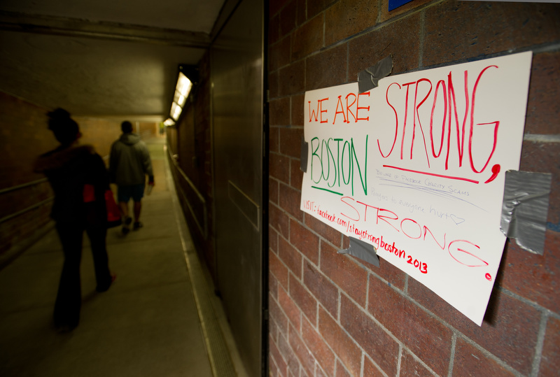 A hand-made sign promotes a fund-raising Facebook page in the Kenmore Square T stop April 20, 2013.