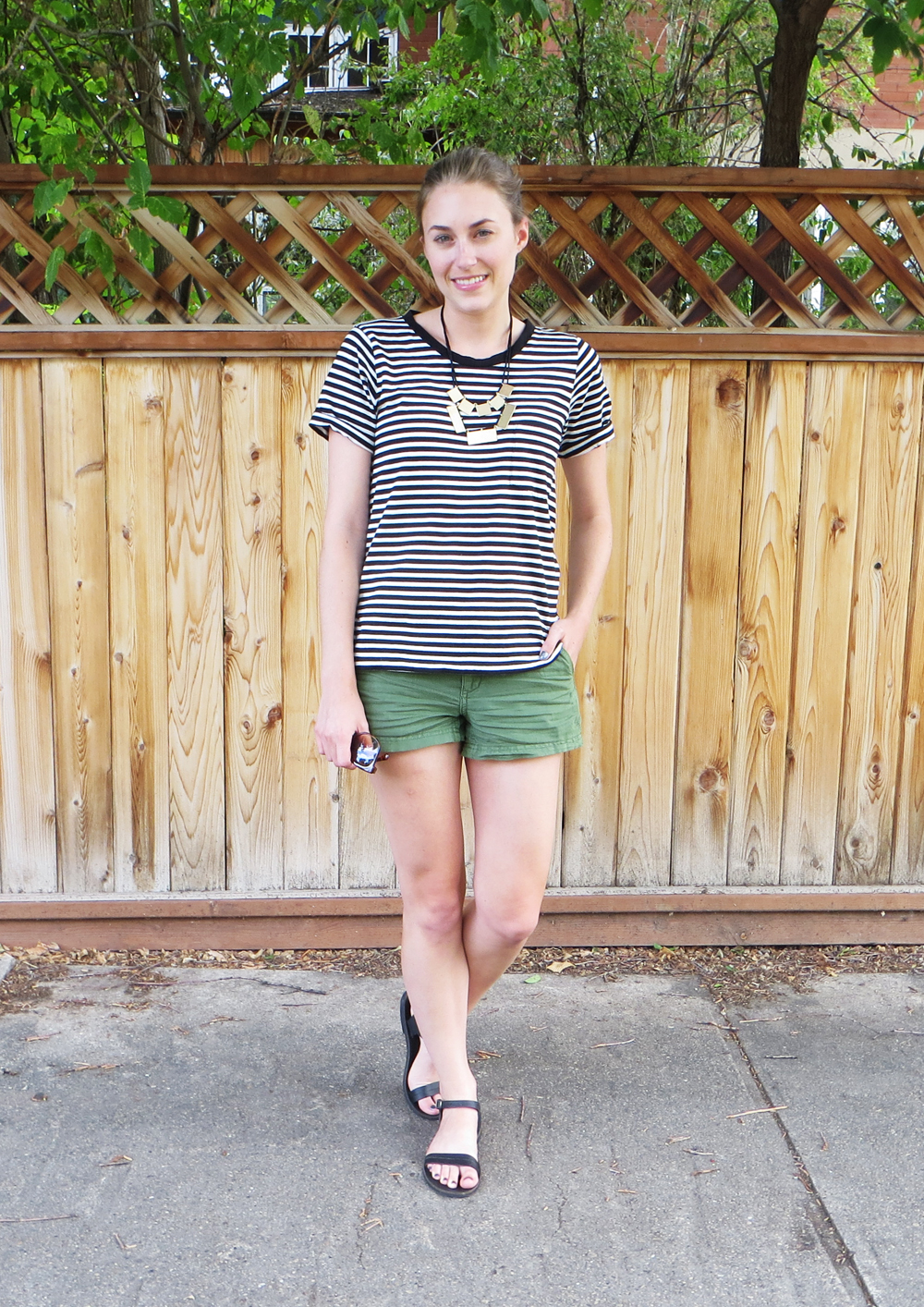 Striped tee, green shorts, geometric necklace, black sandals -- Cotton Cashmere Cat Hair