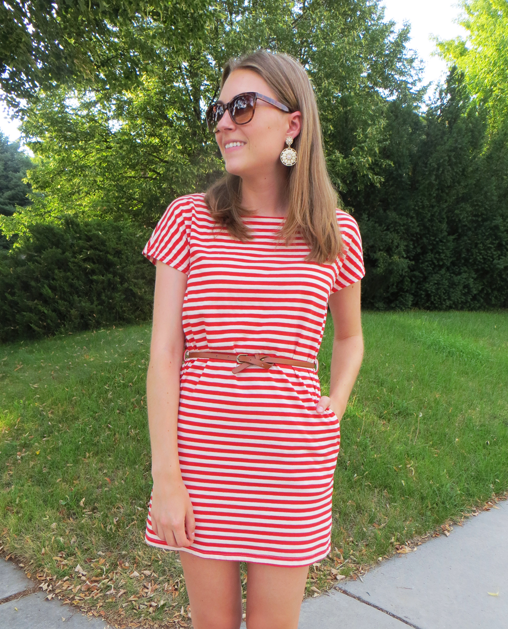 Red striped dress, cognac belt, statement earrings -- Cotton Cashmere Cat Hair