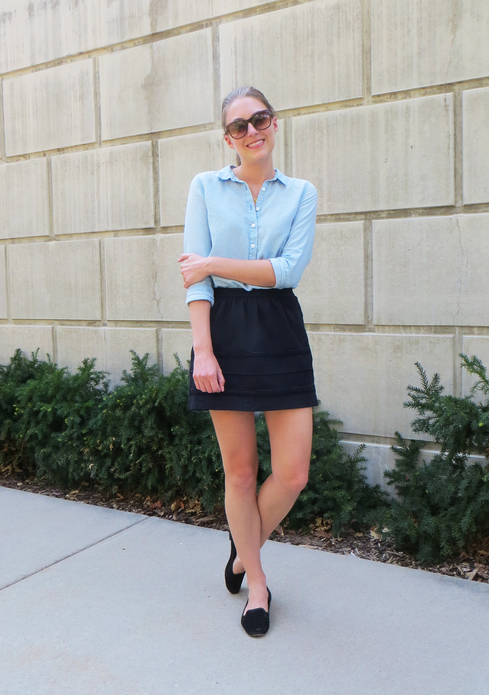 Classics: light blue popover shirt, black mini skirt, black loafers -- Cotton Cashmere Cat Hair