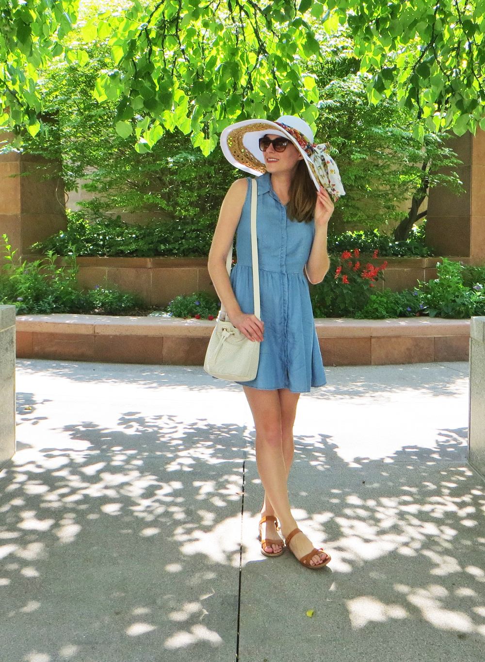 Chambray shirtdress, tan sandals, leather bucket bag, white sun hat -- Cotton Cashmere Cat Hair
