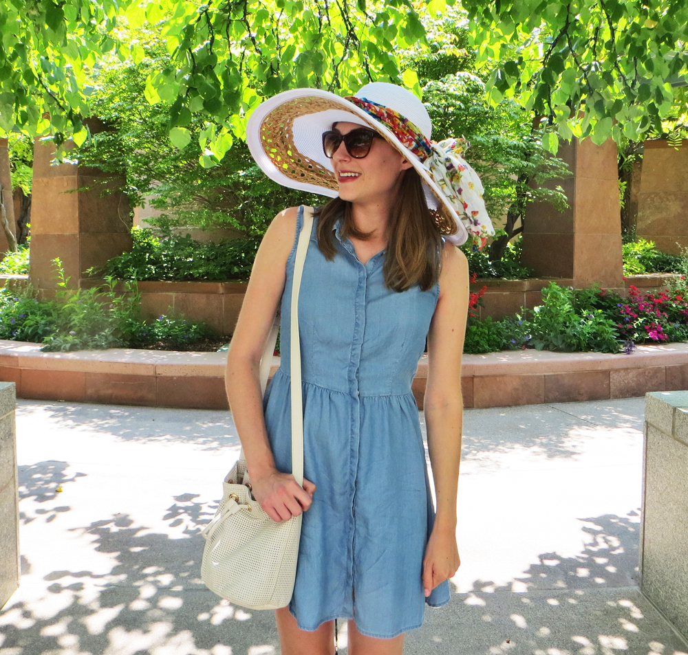 Chambray shirtdress, leather bucket bag, white sun hat, floral scarf -- Cotton Cashmere Cat Hair