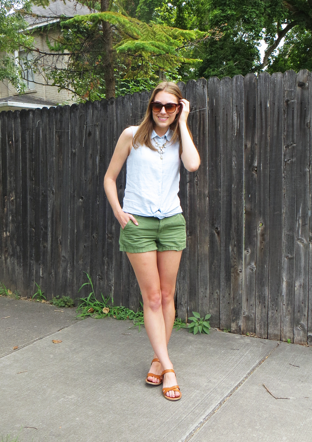 Blue sleeveless shirt, green shorts, tan sandals, statement necklace -- Cotton Cashmere Cat Hair