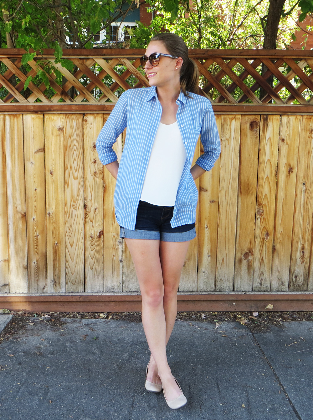 Blue striped shirt, ivory top, dark wash denim shorts, beige flats -- Cotton Cashmere Cat Hair