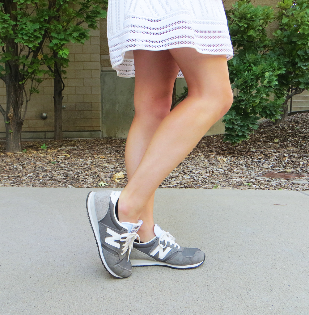 White eyelet skirt and grey New Balance sneakers -- Cotton Cashmere Cat Hair