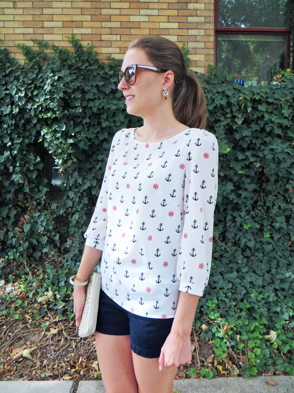 Anchor print top, navy shorts, statement earrings -- Cotton Cashmere Cat Hair