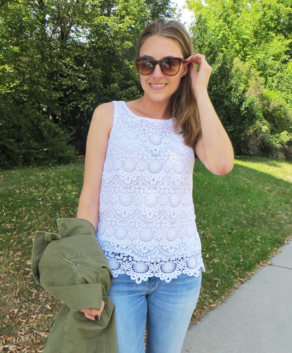 White crocheted top, light wash denim, army green jacket -- Cotton Cashmere Cat Hair