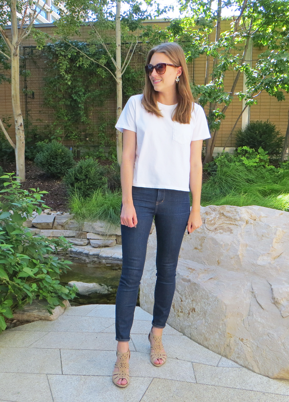 Everlane white tee, dark wash skinny jeans, beige sandals, statement earrings -- Cotton Cashmere Cat Hair