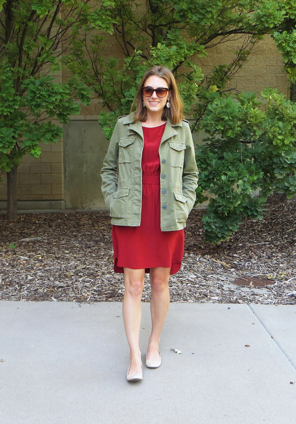 Army green utility jacket, red silk dress, nude flats, statement earrings -- Cotton Cashmere Cat Hair