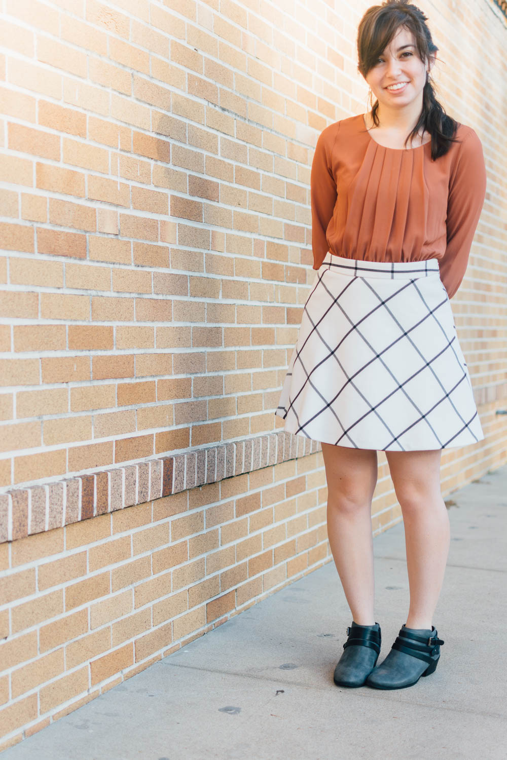 Kaity from Lovely Friend Blog: Burnt orange top, windowpane skirt, grey ankle boots