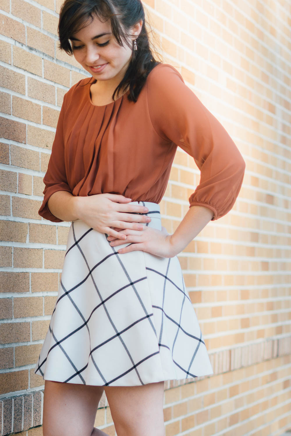Kaity from Lovely Friend Blog: Burnt orange top + windowpane skirt