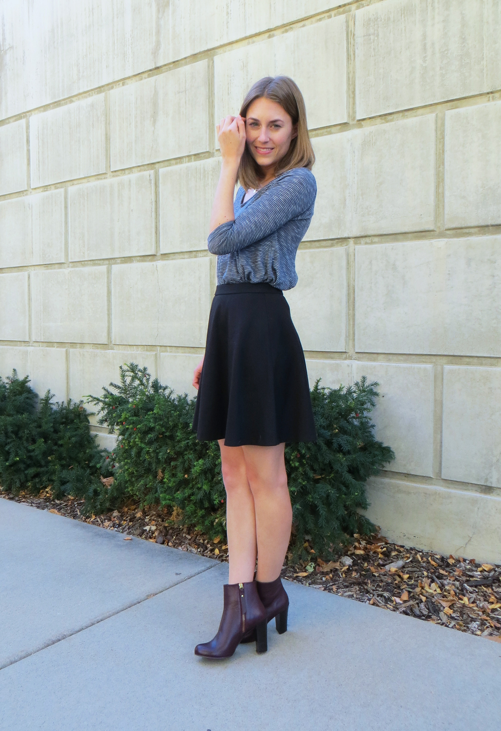Blue striped top, black flared skirt, burgundy ankle boots -- Cotton Cashmere Cat Hair
