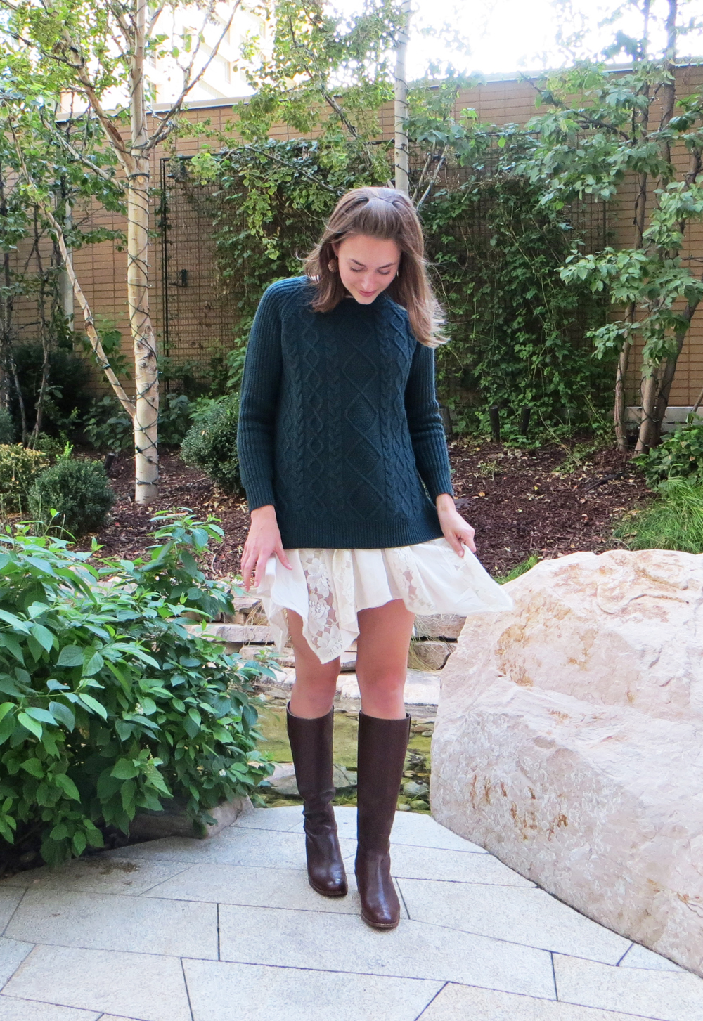 Forest green cable knit sweater, asymmetrical lace dress, brown tall boots -- Cotton Cashmere Cat Hair